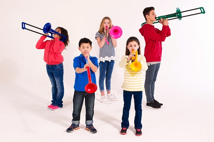 Children playing Warwick Music plastic instruments