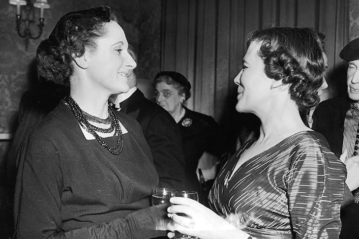 Pamela Hansford Johnson (right) and Elizabeth Taylor at a Book Society party in Knightsbridge in 1954