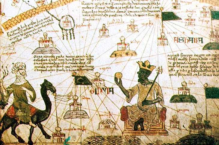 Mansa Musa, King of Mali, holds a sceptre and golden orb in a detail from the Catalan Atlas, 1375