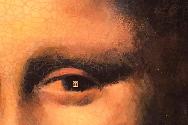 A full-size copy of the Mona Lisa contains, within her eye, another copy of the original, (including the picture frame).Measuring less than a sqmm, it was painted by Willard Wigan with one of his eyelashes. The double portrait was on sale in 2017 for £1million