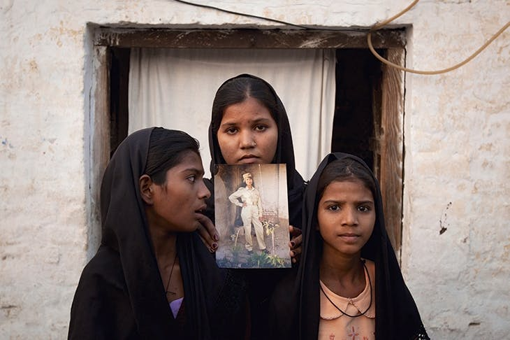 Asia Bibi's daughters with a picture of their mother