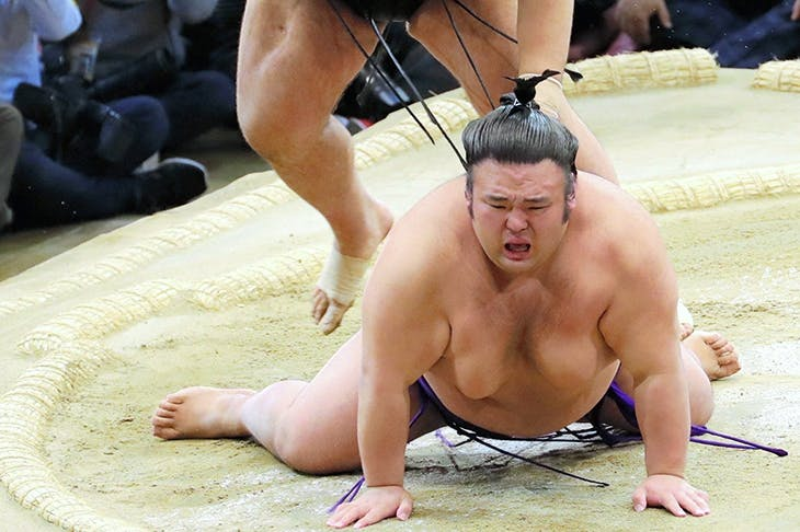 Pounds of flesh: Takayasu throws Takakeisho to the ground to win the 2018 Kyushu tournament in Fukuoka