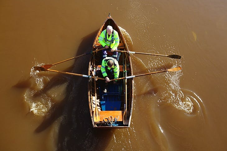Two members of the Glasgow Humane Society on the River Clyde. Photo: Jeff J Mitchell / Getty Images