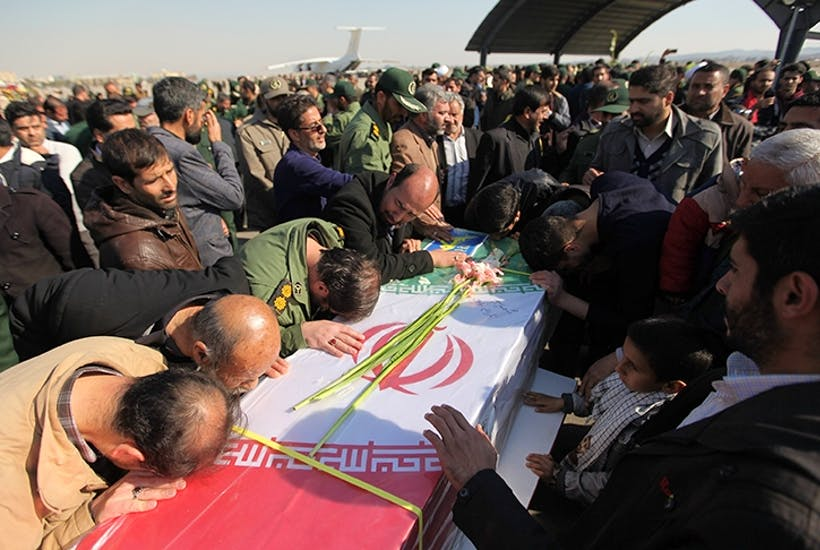 Mourners at the funeral of an Iranian Revolutionary Guard, one of 27 to be killed in a suicide bombing near the Pakistani border last week. (Hamidreza Nikoomaram/Anadolu Agency/Getty Images)