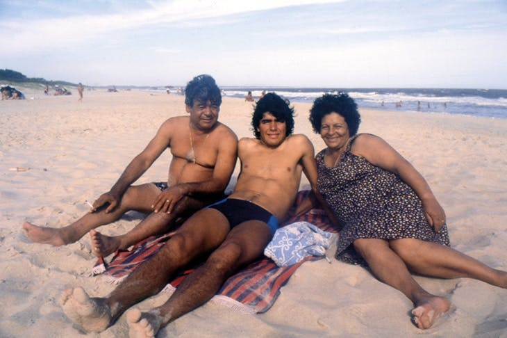 Ball boy: Maradona and his parents