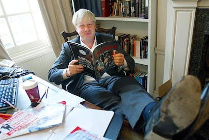 Boris Johnson in The Spectator's editor's chair in 2003 (Jim Watson/AFP/Getty)